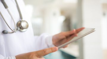 Doctor using tablet computer