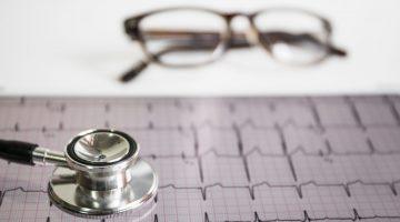 stethoscope-on-cardiogram-with-eyeglasses